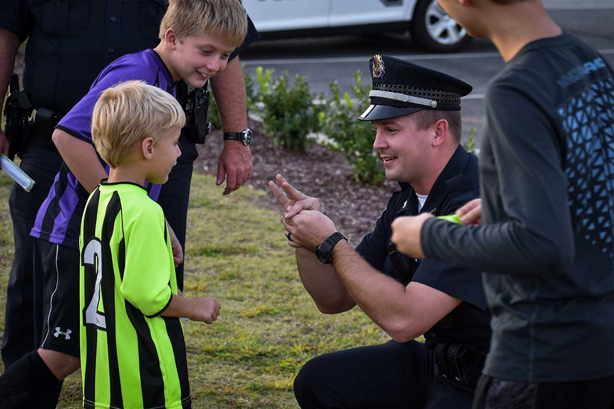 Police Officer playing with kids