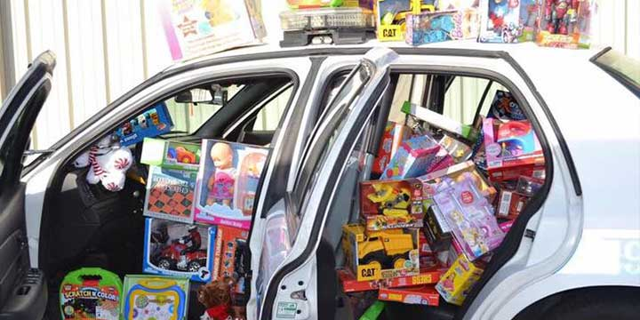 Image of a police car packed with new toys