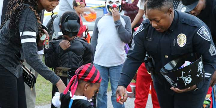 Sumter Police Officer handing out halloween candy