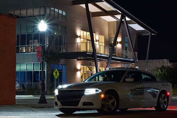 Night image of patrol car in front of SPD headquarters
